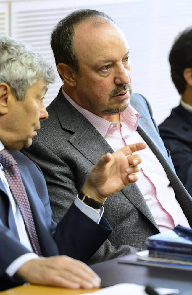 Shaktar Donetsk soccer coach Mircea Lucescu, left, speaks with SSC Napoli's Spanish head coach Rafael Benitez, center, next to Juventus coach Massimiliano Allegri, right, during the 16.  Elite Club Coaches Forum at the UEFA Headquarters in Nyon, Switzerland, Thursday, Sept. 4, 2014