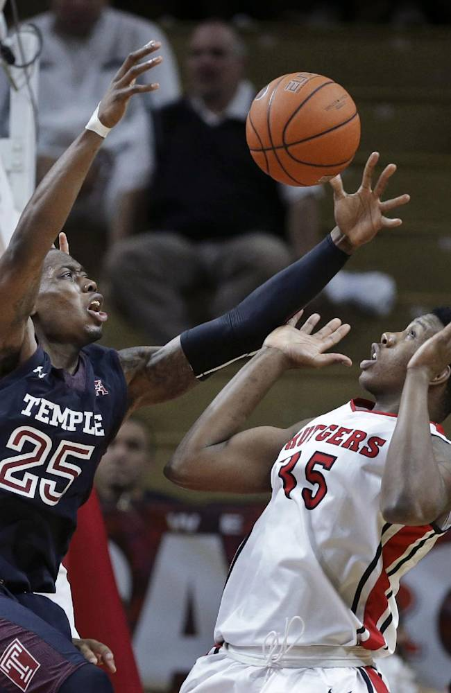 Temple guard Quenton DeCosey (25) reaches for the ball in front of Rutgers forward Greg Lewis (35) during the second half of an NCAA college basketball game in Piscataway, N.J., Wednesday, Jan. 1, 2014. Rutgers won 71-66. DeCosey had 25 points for Temple