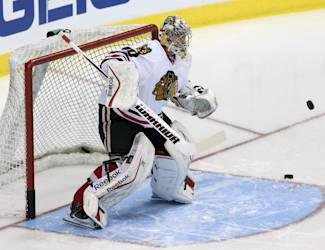 Chicago Blackhawks goalie Kent Simpson warms up before an NHL hockey game against the Dallas Stars, Tuesday, Dec. 10, 2013, in Dallas, Texas. (AP Photo/Sharon Ellman)