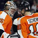 Philadelphia Flyers Steve Mason (35), left, and Brayden Schenn (10), right, celebrate the win in the overtime shoot-out of an NHL hockey game, Tuesday, Jan. 27, 2015, in Philadelphia. The Flyers won 4-3. (AP Photo/Tom Mihalek)