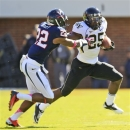 Wake Forest running back Josh Harris (25) tries to break the tackle of Virginia cornerback Drequan Hoskey (22) during the first half of an NCAA college football game at Scott Stadium in Charlottesville, Va., Saturday, Oct. 20, 2012. (AP Photo/Steve Helber)