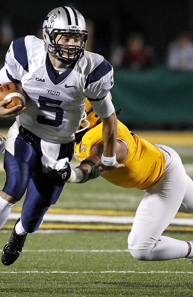 New Hampshire quarterback Sean Goldrich (5) runs past a Southeastern Louisiana defender during the first half of an NCAA college football Division 1 championship quarterfinal game in Hammond, La., Saturday, Dec. 14, 2013