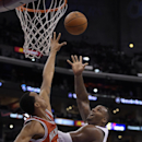Los Angeles Clippers forward Glen Davis, right, puts yup a shot as Milwaukee Bucks center John Henson defends during the first half of an NBA basketball game, Monday, March 24, 2014, in Los Angeles The Associated Press