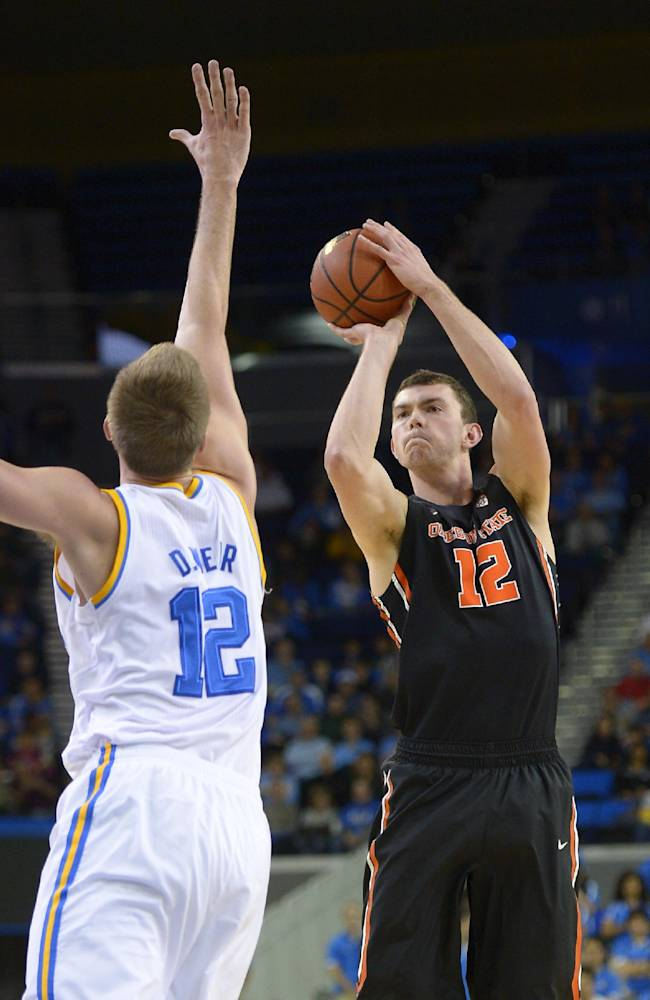Oregon State center Angus Brandt, right, puts up a shot as UCLA forward David Wear defends during the first half of an NCAA college basketball game, Sunday, March 2, 2014, in Los Angeles