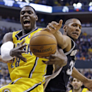 Indiana Pacers center Ian Mahinmi, left, and San Antonio Spurs forward Boris Diaw battle for rebound in the first half of an NBA basketball game in Indianapolis, Monday, March 31, 2014 The Associated Press
