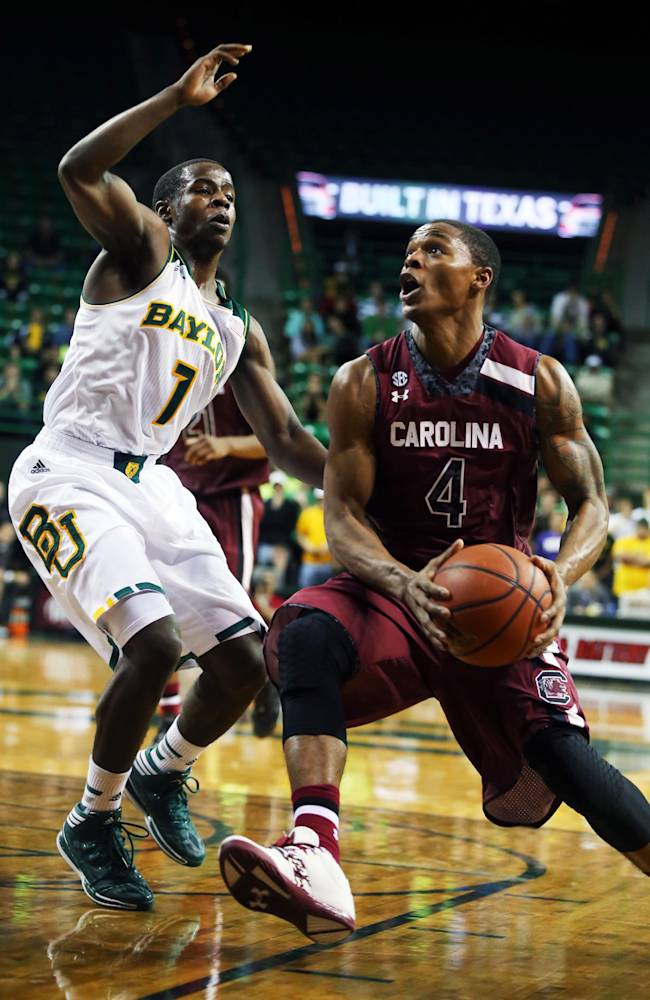 South Carolina's Tyrone Johnson (4), right, drives on Baylor's Kenny Chery (1), left, in the first half of an NCAA college basketball game, Tuesday, Nov. 12, 2013, in Waco, Texas