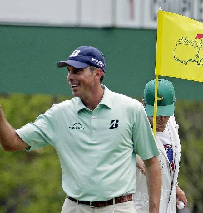Matt Kuchar holds up his ball after a birdie on the third hole during the fourth round of the Masters golf tournament Sunday, April 13, 2014, in Augusta, Ga