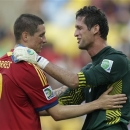 Spain's Fernando Torres gives Tahiti goalkeeper Mikael Roche, right, a pat on the back after they collided during the soccer Confederations Cup group B match between Spain and Tahiti at Maracana stadium in Rio de Janeiro, Brazil, Thursday, June 20, 2013. (AP Photo/Felipe Dana)