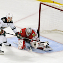 Chicago Blackhawks goalie Corey Crawford (50) makes a save against Minnesota Wild's Mikko Koivu (9) in a shootout during an NHL hockey game in Chicago, Thursday, April 3, 2014. The Blackhawks won 3-2 The Associated Press