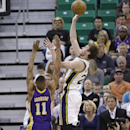 Utah Jazz's Gordon Hayward, right, shoots as Los Angeles Lakers Wesley Johnson (11) defends in the first quarter during an NBA basketball game Monday, April 14, 2014, in Salt Lake City, Utah The Associated Press