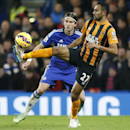 Hull's Ahmed Elmohamady, right, controls the ball under pressure from Chelsea's Filipe Luis during their English Premier League soccer match between Chelsea and Hull City at Stamford Bridge stadium in London, Saturday, Dec. 13, 2014