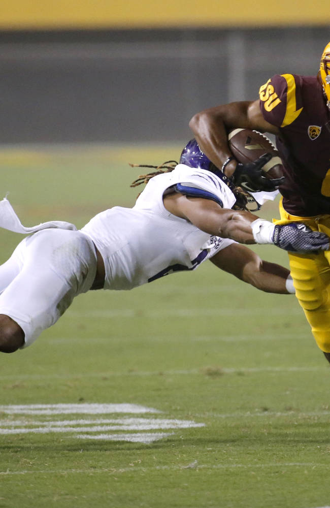 Arizona State wide receiver Cameron Smith (6) avoids the tackle of Weber State cornerback Cordero Dixon during the first half of an NCAA college football game, Thursday, Aug. 28, 2014, in Tempe, Ariz