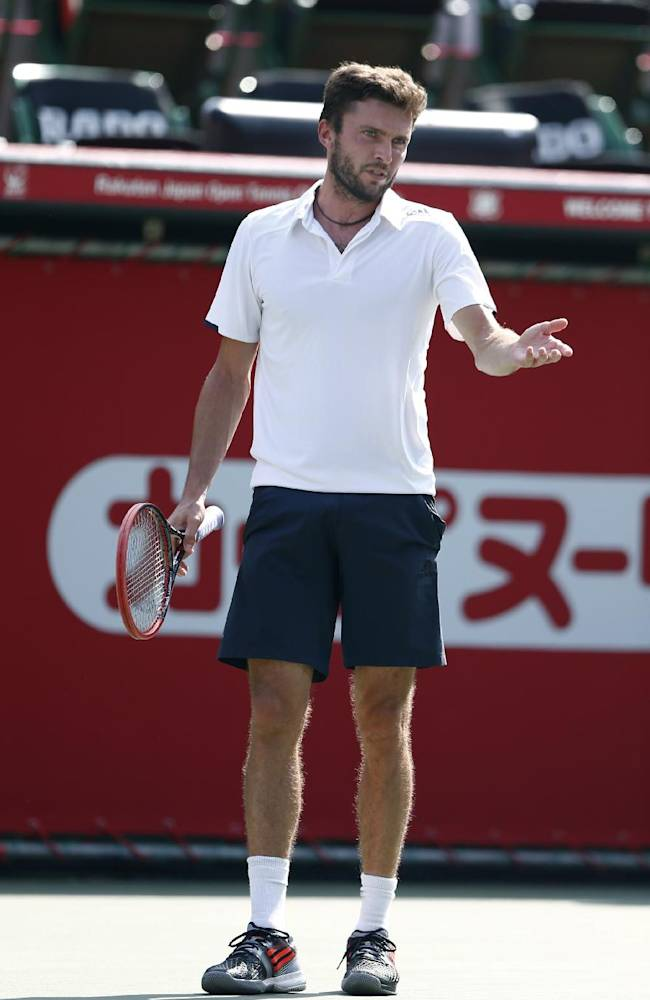 Gilles Simon of France reacts after losing a point against  Roberto Bautista Agut of Spain during their first round match of the Japan Open tennis championships in Tokyo, Tuesday, Sept. 30, 2014