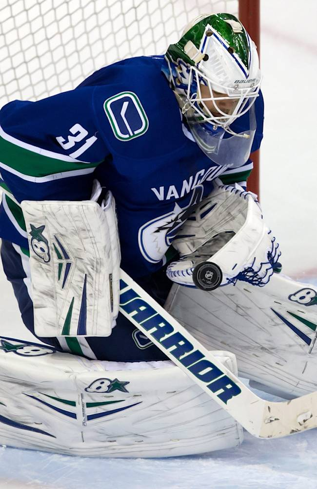 Vancouver Canucks' goalie Eddie Lack, of Sweden, makes a save against the St. Louis Blues during second period NHL hockey action in Vancouver, British Columbia on Wednesday, Feb. 26, 2014