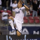 Vancouver Whitecaps FC Camilo Sanvezzo celebrates his goal against Chivas USA during the first half of an MLS soccer game in Vancouver, British Columbia, Wednesday, June, 19, 2013. (AP Photo/The Canadian Press, Jonathan Hayward)