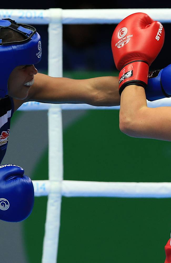 Australia's Shelly Watts, right, competes in the women's light 57-60Kg weight with England's Natasha Jonas at the SECC, during the 2014 Commonwealth Games in Glasgow, Scotland, Tuesday, July 29, 2014