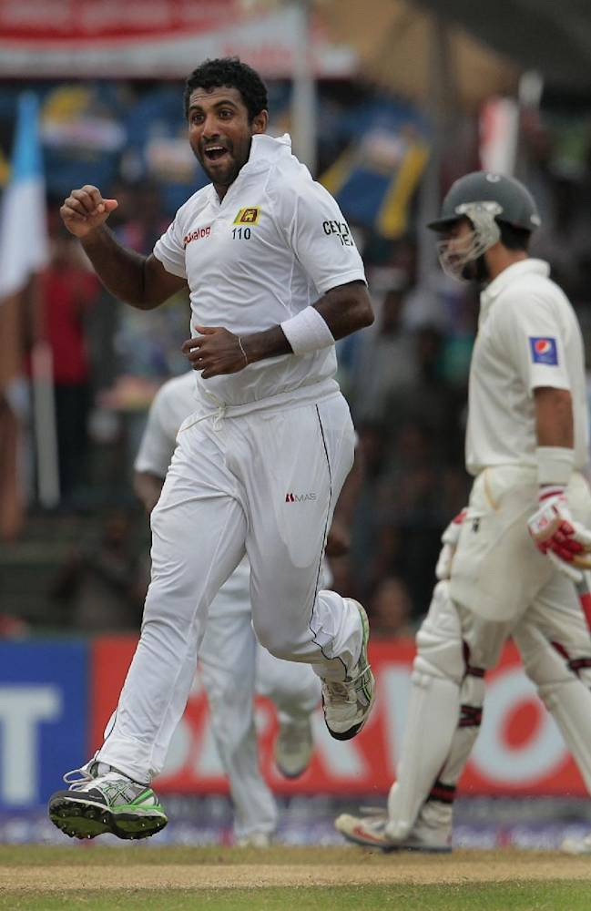 Sri Lankan bowler Dhammika Prasad celebrates the dismissal  of Pakistani batsman Khurram Manzoor during the fourth day of their second test cricket match  in Colombo, Sri Lanka, Sunday, Aug. 17, 2014