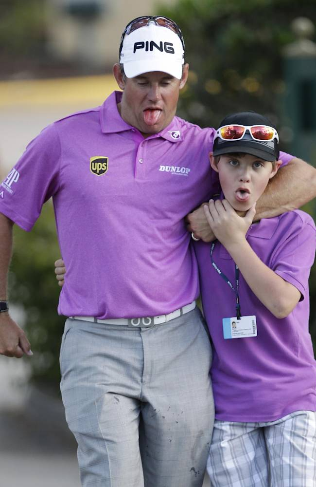 Lee Westwood, left, of England, jokes with his son Sam as they leave after Westwood played the final round of the Honda Classic golf tournament, Sunday, March 2, 2014 in Palm Beach Gardens, Fla