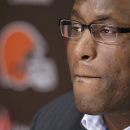 FILE - In this Dec. 30, 2014, file photo, Cleveland Browns general manager Ray Farmer answers questions about the Browns' season during an NFL football news conference in Berea, Ohio. The NFL has suspended Browns general manager Ray Farmer for four games for sending text messages to the sideline last season during games. Farmer has acknowledged sending the messages, which is prohibited under league rules. The league's punishment handed down on Monday, March 30, 2015, includes a $250,000 fine on the Browns. (AP Photo/Tony Dejak)