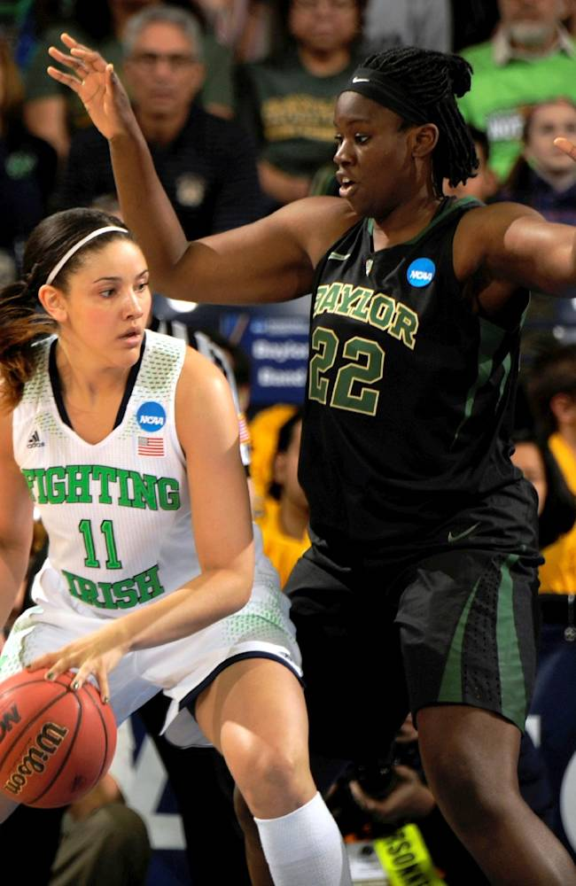 Notre Dame forward Natalie Achonwa drives the lane as Baylor center Sune Agbuke defends in the first half of their NCAA women's college basketball tournament regional final game at the Purcell Pavilion in South Bend, Ind., Monday March 31, 2014