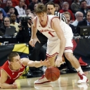 Wisconsin's Ben Brust and Indiana's Jordan Hulls battle for a loose ball during the first half of an NCAA college basketball game at the Big Ten tournament Saturday, March 16, 2013, in Chicago. (AP Photo/Charles Rex Arbogast)