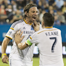 L.A. Galaxy's Alan Gordon, left, celebrates with teammate Robbie Keane after scoring against the Montreal Impact during the second half of a soccer game, Wednesday, Sept. 10, 2014 in Montreal The Associated Press