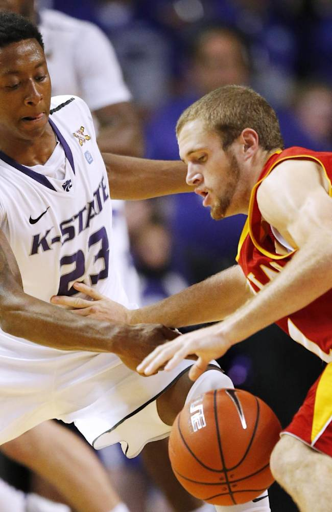 Kansas State guard Nigel Johnson (23) steals the ball from Pittsburg State guard Jake Bullard (1) during the second half of an exhibition NCAA college basketball game in Manhattan, Kan., Friday, Nov. 1, 2013