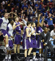 Stephen F. Austin players react as Desmond Haymon sinks a 3-point jumper to pull them to within one point of Virginia Commonwealth in the final moments of regulation in the second half of a second-round game in the NCAA college basketball tournament Friday, March 21, 2014, in San Diego. Stephen F. Austin won 77-75 in overtime. (AP Photo/Denis Poroy)
