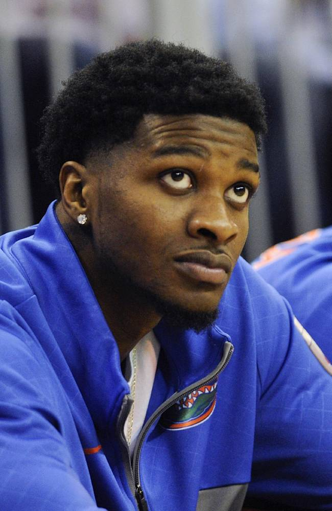 In this photo taken on Jan. 14, 2014, Florida's Chris Walker watches from the sidelines in Gainesville, Fla. The NCAA cleared the highly touted freshman on Wednesday, Jan. 29, 2014, and said he will be eligible to play Tuesday night against Missouri