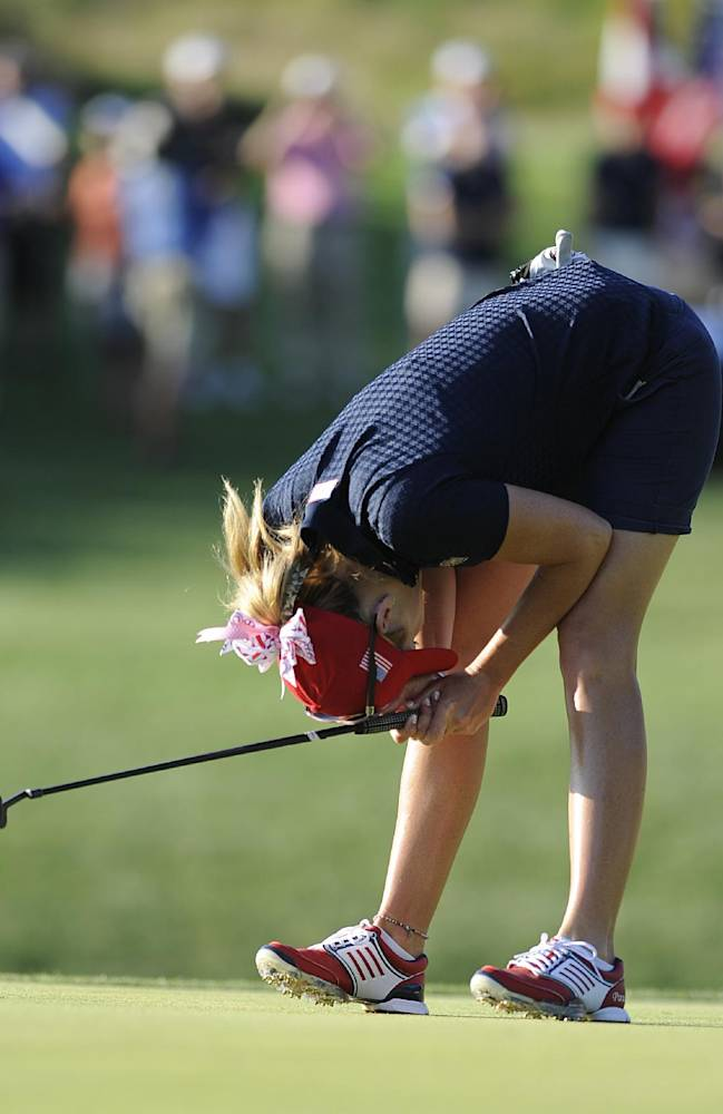 United States' Paula Creamer reacts after missing a putt on the 17th hole during the third round of the International Crown golf tournament Saturday, July 26, 2014, in Owings Mills, Md