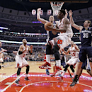 The Memphis Grizzlies defense of Kosta Koufos (41) and Jon Leuer (30) force Chicago Bulls shooting guard Jimmy Butler (21) to pass under the basket during the first half of an NBA basketball game on Friday, March 7, 2014, in Chicago The Associated Press