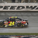 FILE - In this May 10, 2014, file photo, NASCAR driver Jeff Gordon (24) crosses the finish line to win the Sprint Cup Series auto race at Kansas Speedway in Kansas City, Kan. Gordon says he will retire as a full-time driver after 2015 season. (AP Photo/Orlin Wagner, File)