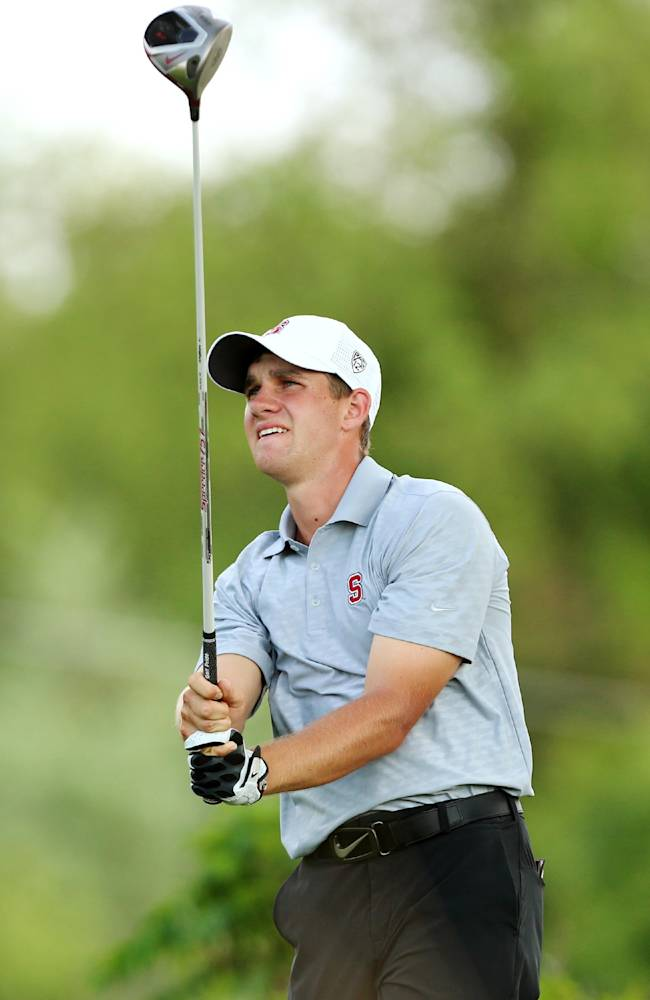 Stanford's Patrick Rodgers tees off on seventh hole during the second round of the NCAA college men's golf championship on Saturday, May 24, 2014, at Prairie Dunes Country Club in Hutchinson, Kan