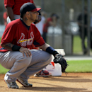 St. Louis Cardinals catcher Yadier Molina takes up his position behind the plate during spring training baseball practice Monday, Feb. 24, 2014, in Jupiter, Fla The Associated Press