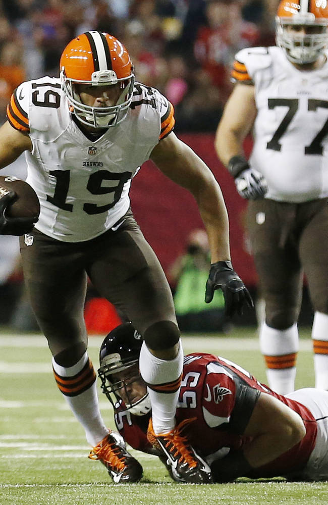 Cleveland Browns wide receiver Miles Austin (19) is hit by Atlanta Falcons inside linebacker Paul Worrilow (55) during the first half of an NFL football game, Sunday, Nov. 23, 2014, in Atlanta
