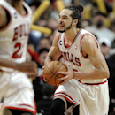 Chicago Bulls' Joakim Noah, right, looks to pass after grabbing a rebound during overtime of an NBA basketball game against the Miami Heat in Chicago, Sunday, March 9, 2014. The Bulls won 95-88 in overtime The Associated Press
