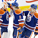 Edmonton Oilers goalie Ben Scrivens (30), Jeff Petry (2) and Andrew Ference (21) celebrate the win over the Montreal Canadiens during NHL hockey action in Edmonton, Alberta, on Monday, Oct. 27, 2014 The Associated Press