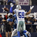 Dallas Cowboys outside linebacker Anthony Hitchens (59) gets hit in the back by a pass to Detroit Lions tight end Brandon Pettigrew (87) during the fourth quarter of an NFL wildcard playoff football game, Sunday, Jan. 4, 2015, in Arlington, Texas The Asso