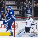 Toronto Maple Leafs forward James van Riemsdyk (21) celebrates after scoring past Los Angeles Kings goalie Jonathan Quick during third period NHL hockey action in Toronto on Sunday, Dec. 14, 2014 The Associated Press