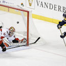 Nashville Predators defenseman Shea Weber, right, scores against Ottawa Senators goalie Craig Anderson (41) and defenseman Jared Cowen (2) in the third period of an NHL hockey game Thursday, Oct. 9, 2014, in Nashville, Tenn. The Predators won 3-2 The Asso