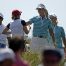 The match is conceded to Europe's Anna Nordqvist, of Sweden, center, and teammate Caroline Hedwall, right, of Sweden, after Nordqvist made a hole in one on the 17th hole during their foursome match in the Solheim Cup golf tournament, Saturday, Aug. 17, 2013, in Parker, Colo. (AP Photo/Chris Carlson)