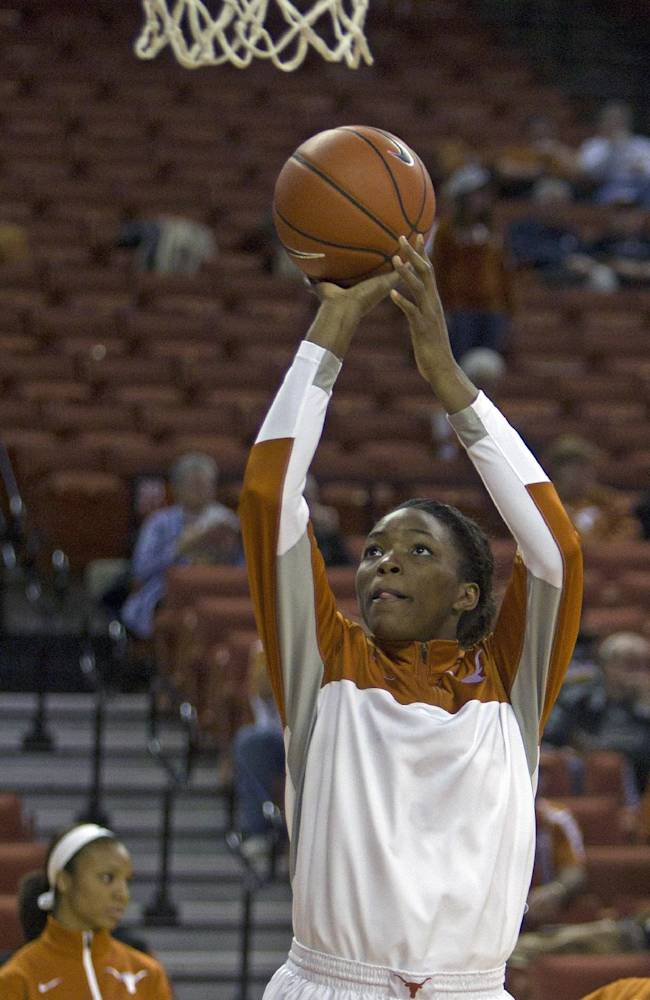 Texas forward Nneka Enemkpali warms up before an NCAA college basketball game against Stanford, Saturday, Nov. 23, 2013, in Austin, Texas