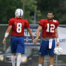 Indianapolis Colts quarterback Andrew Luck, left, greets quarterback Matt Hasselbeck after a drill during an NFL football training camp in Anderson, Ind., Saturday, July 26, 2014 The Associated Press