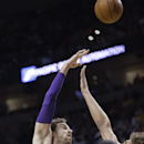 Los Angeles Lakers center Pau Gasol, from Spain, left, shoots over the Portland Trail Blazers, from right, Robin Lopez, LaMarcus Aldridge and Nicolas Batum, from France, during the first half of an NBA basketball game in Portland, Ore., Monday, March 3,