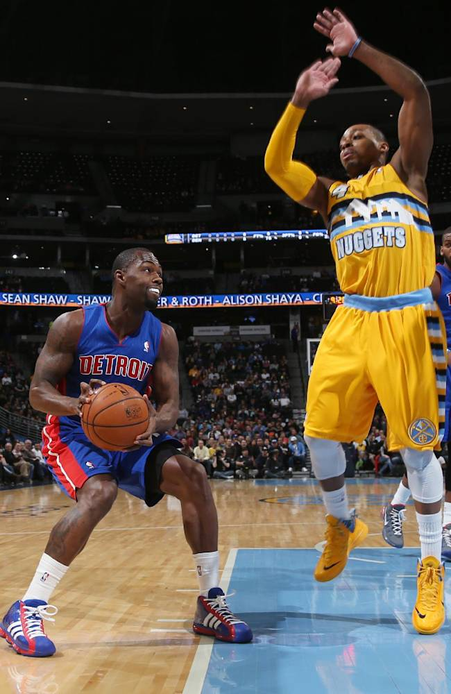 Detroit Pistons guard Rodney Stuckey, left, dodges the attempted block by Denver Nuggets guard Randy Foye in the first quarter of an NBA basketball game in Denver on Wednesday, March 19, 2014