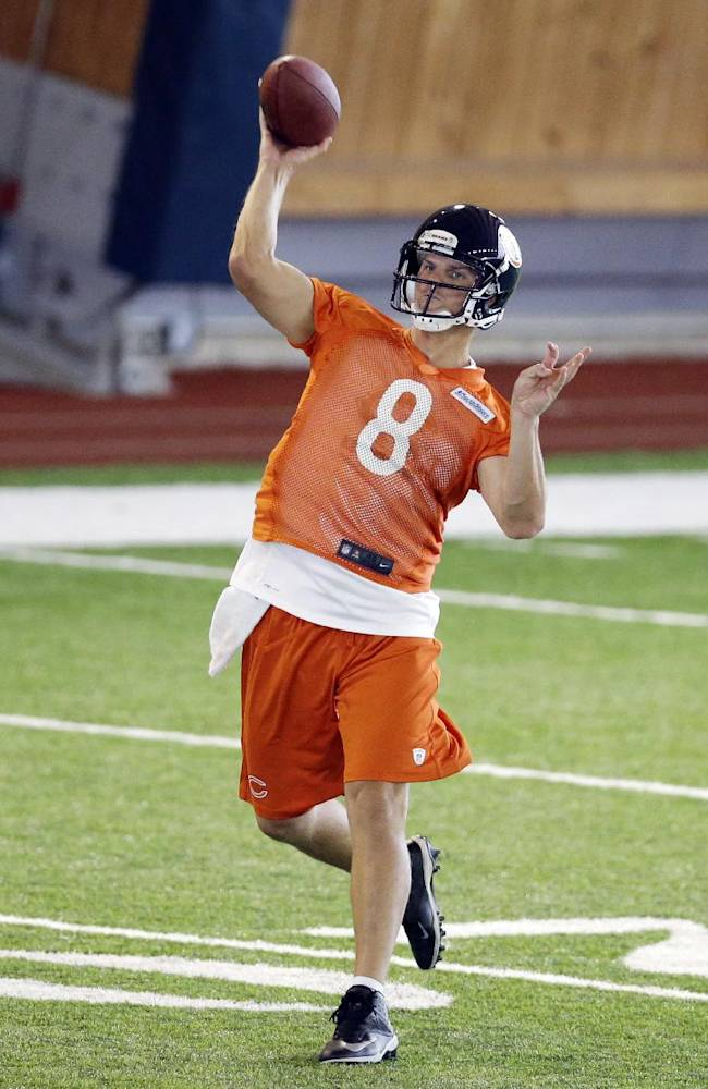 Chicago Bears quarterback Jimmy Clausen (8) throws a pass during NFL football practice in Lake Forest, Ill., Wednesday, June 11, 2014