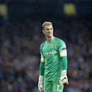 Manchester City's goalkeeper Joe Hart stands under the rain during a Champions League group E soccer match between Manchester City and Roma at the Etihad Stadium, Manchester, England, Tuesday, Sept. 30, 2014. The match ended 1-1