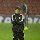 Real Madrid's Cristiano Ronaldo reacts as he stands in a heavy rain shower as he trains with teammates at Anfield Stadium, in Liverpool, England, Tuesday, Oct. 21, 2014. Real Madrid will play Liverpool in a Champion's League Group B soccer match on Wednes