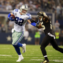 Dallas Cowboys tight end Jason Witten (82) is tackled by New Orleans Saints free safety Rafael Bush during the second half of an NFL football game Sunday, Sept. 28, 2014, in Arlington, Texas. The Associated Press