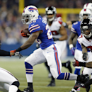 Buffalo Bills running back C.J. Spiller (28) runs for a touchdown against the Atlanta Falcons during the second half of an NFL football game on Sunday, Dec. 1, 2013, in Toronto The Associated Press